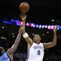 Photo - OKLAHOMA CITY THUNDER / UTAH JAZZ / NBA BASKETBALL  Oklahoma City's Russell Westbrook shoots over Utah's Paul Millsap during the Thunder - Jazz game March 20, 2009 in the Ford Center in Oklahoma City.    BY HUGH SCOTT, THE OKLAHOMAN ORG XMIT: KOD