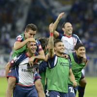Photo - Argentina's San Lorenzo players, celebrate their victory over Brazil's Cruzeiro during a Copa Libertadores soccer match in Belo Horizonte, Brazil, Wednesday, May 14, 2014. San Lorenzo won with an aggregate score of 2-1.  (AP Photo/Eugenio Savio)