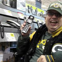 Photo -   Sean Irvin browses phones at a Best Buy store Monday, Sept. 17, 2012, in Anchorage, Alaska. It's one of the ways Irvin plans to spend his yearly Alaska Permanent Fund dividend, whose amount was being announced Tuesday. (AP Photo/Rachel D'Oro)