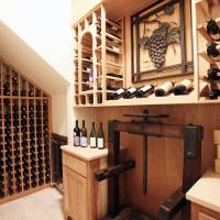 Photo - Left: Rick Wolf, working with UBuildIt, designed and installed storage space in the wine closet of his home in Edmond. PHOTO BY PAUL HELLSTERN, THE OKLAHOMAN