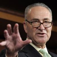 "Photo -   FILE - In this May 17, 2012 file photo, Sen. Charles Schumer, D-N.Y. gestures during a news conference on Capitol Hill in Washington. Republican leaders say the government can raise tax ""revenue"" without raising tax ""rates."