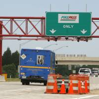 Photo - Cars pass through the PikePass lane on the Kilpatrick Turnpike in Oklahoma City, OK, Tuesday, June 2, 2009. By Paul Hellstern, The Oklahoman ORG XMIT: KOD