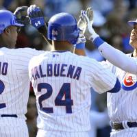 Photo -   Chicago Cubs' Starlin Castro, right, celebrates with teammates Alfonso Soriano (12) and Luis Valbuena (24) after hitting a three-run home run in the sixth inning during a baseball game against the Pittsburgh Pirates in Chicago, Friday, Sept. 14, 2012. (AP Photo/Paul Beaty)