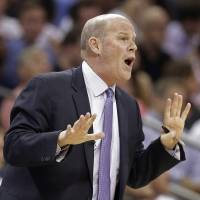 Photo - Charlotte Bobcats coach Steve Clifford talks to his players during the first half in Game 4 of an opening-round NBA basketball playoff series against the Miami Heat in Charlotte, N.C., Monday, April 28, 2014. (AP Photo/Chuck Burton)