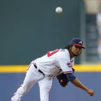 Photo - Atlanta Braves starting pitcher Ervin Santana delivers in the first inning of a baseball game against the Philadelphia Phillies Tuesday, June 17, 2014, in Atlanta. (AP Photo/Todd Kirkland)