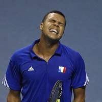 Photo - French tennis player Jo-Wifried Tsonga grimaces after missing a point during his single match against German player Peter Gojowczyk, in the quarterfinals of the Davis Cup in Nancy, eastern France, Friday April 4, 2014. France plays against Germany from Friday April 4 to Sunday April 6. (AP Photo/Remy de la Mauviniere)