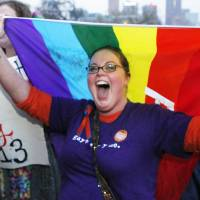 Photo - Rachel Ford cheers during a rally supporting a same-sex marriage bill in Minnesota on the steps of the State Capitol  in St. Paul, Minn., on Wednesday May 8, 2013. The Minnesota House is scheduled to debate and vote Thursday on a measure that would make the state the 12th in the country to allow gay marriage. (AP Photo/Andy Clayton King)