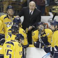 Photo - Nashville Predators head coach Barry Trotz talks to his team during a stop in play against the Dallas Stars in the second period of an NHL hockey game on Monday, Feb. 25, 2013, in Nashville, Tenn. (AP Photo/Mark Humphrey)