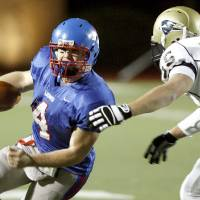 Photo - Jack Gray of Chandler tries to get past Matt Morrow of Heritage Hall during the Class 2A state championship high school football game between Heritage Hall and Chandler High School at Putnam City, Saturday, Dec. 13, 2008. PHOTO BY BRYAN TERRY, THE OKLAHOMAN  ORG XMIT: KOD