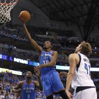 Photo -   Oklahoma City Thunder small forward Kevin Durant (35) shoots past Dallas Mavericks power forward Dirk Nowitzki (41) of Germany as Thunder center Nazr Mohammed (8) looks on during the half of Game 4 in a first-round NBA basketball playoff series, Saturday, May 5, 2012, in Dallas. (AP Photo/LM Otero)
