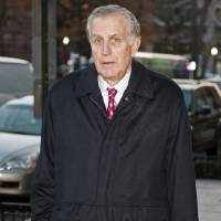 Photo - FILE - In this Nov. 30, 2012, file photo, former NFL commissioner Paul Tagliabue arrives at an attorney's office in Washington for a hearing on the bounty system of the New Orleans Saints NFL football team. Tagliabue, who was appointed to handle a second round of player appeals to the league, has informed all parties he planned to rule by Tuesday, Dec. 11_giving four players a ruling on whether their initial suspensions are upheld, reduced or thrown out. (AP Photo/Cliff Owen, File)