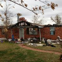 Photo - The home of Ted and Cheryl Hover in Carney was first damaged by a tornado May 19, then destroyed by an electrical fire Aug. 23. Before the fire, their insurer told them it was livable. Now, they are one of 28 homeowners suing over claims they filed after the May tornadoes. Photo provided