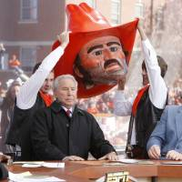 Photo - Co-hosts Desmons Howard (left) and Kirk Herbstreit laugh as Lee Corso dons the head of OSU mascot Pistol Pete, during Saturday's ESPN College Gameday broadcast in Stillwater, OK, Saturday, Nov. 27, 2010. By Paul Hellstern, The Oklahoman ORG XMIT: KOD