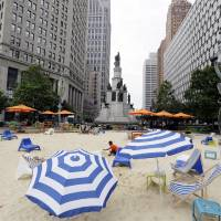 Photo - In this June 23, 2014, photo, a beach scene is displayed at Campus Martius in Detroit. Campus Martius is a 1.6-acre park where the historic Woodward and Michigan avenues converge. It opened in 2004 after several years of plans and more than $20 million in donations. (AP Photo/Carlos Osorio)