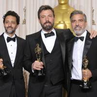 Photo - Grant Heslov, from left, Ben Affleck, and George Clooney pose with their award for best picture for