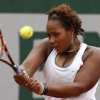 Photo - Taylor Townsend, of the U.S, returns the ball to France's Alize Cornet during the second round match of  the French Open tennis tournament at the Roland Garros stadium, in Paris, France, Wednesday, May 28, 2014. (AP Photo/Darko Vojinovic)
