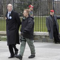 Photo - Sierra Club Executive Director Michael Brune is arrested outside the White House in Washington, Wednesday, Feb. 13, 2013, as prominent environmental leaders tied themselves to the White House gate to protest the Keystone XL oil pipeline..  (AP Photo/Ann Heisenfelt)