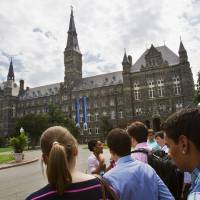 Photo - FILE - In this July 10, 2013 file photo, prospective students tour Georgetown University's campus in Washington. The Senate could vote as early as Thursday on a bipartisan compromise that heads off a costly increase for returning students.  (AP Photo/Jacquelyn Martin)