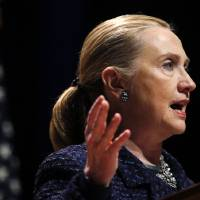 Photo - Secretary of State Hillary Rodham Clinton gestures as she gives a speech: