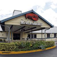 Photo - FILE - This Thursday, Sept. 6, 2012, file photo, shows a Red Lobster restaurant in Hialeah, Fla. Darden's fiscal fourth-quarter profit dropped 35 percent, dragged down by charges and costs tied to its strategic plan to reshape the restaurant company.Its shares dropped more than 3 percent in premarket trading Friday June 20, 2014. (AP Photo/Alan Diaz, File)