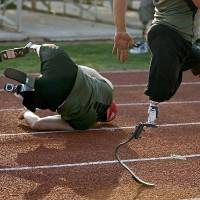 Photo -  Ugur Yumuk of Turkey falls down while training in Edmond, Okla., Wednesday, June 8, 2011. Yumuk will be running at the Endeavor games for the first time. Photo by Bryan Terry, The Oklahoman