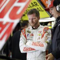 Photo - Dale Earnhardt Jr., left, talks with his crew chief Steve Letarte in the garage during a practice session for the NASCAR Sprint Cup Series auto race at Texas Motor Speedway in Fort Worth, Texas, Saturday, April 5, 2014. (AP Photo/LM Otero)