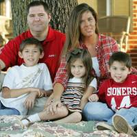 Photo - FAMILY / CHAD GOLEY / CHANDLER GOLEY / PEYTON GOLEY / CHASE GOLEY: Chad and Sabrena Goley with their children Chandler, 8, Peyton, 4, and Chase, 6,  at their home in Edmond, Oklahoma November 5, 2009. Photo by Steve Gooch, The Oklahoman ORG XMIT: KOD