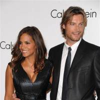 Photo - FILE - In this Sept. 7, 2008 file photo, Model Gabriel Aubry and actress Halle Berry attends the Calvin Klein 40th anniversary party during Fashion Week in New York. Berry's ex-boyfriend Aubry was arrested for investigation of battery after he and the Oscar-winning actress' current boyfriend got into a fight at her California home, police said Thursday, Nov. 22, 2012. (AP Photo/Peter Kramer, File)