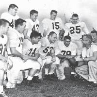 Photo - Former OU coach Bud Wilkinson talks with players on Dec. 29, 1955, as the team prepared for the Orange Bowl. Players are, top row from left, Robert Burris, Billy Pricer, Jim Harris and Tommy McDonald. On the bottom row are John Bell, Edmon Gray, Cecil Morris, Jerry Tubbs, Bo Bolinger, Wilkinson and Calvin Woodworth. The team was part of OU's 47-game winning streak, which stretched from 1953-57. - OKLAHOMAN ARCHIVE  OKLAHOMAN ARCHIVE