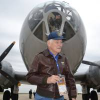 Photo - Albert Wheeler, 88, prepares to board the B-29 Superfortress known as FIFI on Saturday at Wiley Post Airport in Bethany. Photo by Zeke Campfield, The Oklahoman  Zeke Campfield - Zeke Campfield