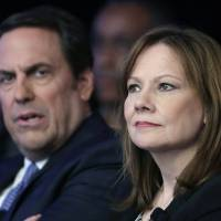 Photo -  Mary Barra, CEO of General Motors, and Mark Reuss, executive vice president of Global Product Development for GM and president of GM America, watch the introduction of new Chevrolet cars April 15 at the New York International Auto Show in New York.    Mark Lennihan -  AP