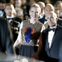 Photo - Head of Dreamworks Jeffrey Katzenberg, right, and actress Cate Blanchett leave after the screening of How To Train Your Dragon 2 at the 67th international film festival, Cannes, southern France, Friday, May 16, 2014. (AP Photo/Thibault Camus)