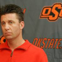 Photo - Oklahoma State University (OSU) college football head coach Mike Gundy talks about the upcoming Holiday Bowl football game with the Oregon Ducks during a media luncheon in Stillwater , Okla. December 17, 2008.  BY STEVE GOOCH, THE  OKLAHOMAN. ORG XMIT: KOD