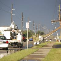 Photo - Downed  power poles are seen on the east side of Lawton, Okla., after a storm Monday, May, 28, 2012. Winds of 65 miles per hour were clocked nearby in Fletcher, Okla., and hail up to tennis-ball size was reported.  (AP Photo/The Constitution, Jeff Dixon) ORG XMIT: OKLAW101