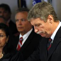 Photo - Jim Letten, U.S. Attorney for the Eastern District, announces his resignation during a news conference in New Orleans, Thursday, Dec. 6, 2012. Seconld left is his wife JoAnn Letten. Letten said his resignation is effective Dec. 11 and that he plans to stay on with the department briefly to help with the transition in leadership.  (AP Photo/Gerald Herbert)