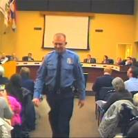 Photo - In this  Feb. 11, 2014 image from video released by the City of Ferguson, Mo., officer Darren Wilson attends a city council meeting in Ferguson.  Police identified Wilson, 28,  as the police officer who shot Michael Brown on Aug. 9, 2014, sparking over a week of protests in the suburban St. Louis town.  (AP Photo/City of Ferguson)
