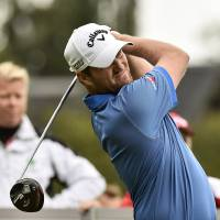 Photo - Scotland's Marc Warren watches his tee shot during the final round of the European Tour Golf Tournament in Himmerland, Denmark, Sunday, Aug. 17, 2014. (AP Photo/Rene Schutze, POLFOTO) DENMARK OUT