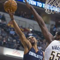 Photo - Charlotte Bobcats' Ramon Sessions (7) drives against Indiana Pacers' Roy Hibbert (55) during the first half of an NBA basketball game in Indianapolis, Saturday, Jan. 12, 2013. (AP Photo/Doug McSchooler)