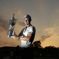 Photo - Martin Kaymer, of Germany, poses with the trophy after wining the U.S. Open golf tournament in Pinehurst, N.C., Sunday, June 15, 2014. (AP Photo/Charlie Riedel)