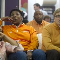 Photo - Tennessee head coach Holly Warlick, right, watches the selection show with assistant coaches, Jolette Law, center, and Kyra Elzy at the Women's Basketball Hall of Fame in Knoxville, Tenn. on  Monday, March 17, 2014. Tennessee received a no. 1 seed in the Louisville Regional of the NCAA Tournament.  (AP Photo/The Knoxville News Sentinel, Saul Young)