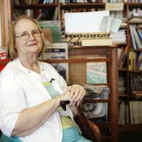 Photo - Paula Walker, managing partner at Aladdin Book Shoppe, struggled for six months over whether to close the city's oldest book store.  KT King
