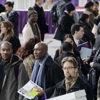 Photo - FILE - In this March 14, 2013, file photo, a crowd of job seekers attends a health care job fair in New York. Just how sturdy is the U.S. job market? That's the key question the Federal Reserve will face when it decides later in September 2013, whether to reduce its economic stimulus. (AP Photo/Mark Lennihan, File)