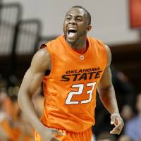 Photo - CELEBRATION: OSU's James Anderson celebrates during the NCAA college basketball game between Oklahoma State University and Texas Tech at Gallagher-Iba Arena in Stillwater, Okla., Saturday January 9, 2010. Photo by Bryan Terry, The Oklahoman ORG XMIT: KOD