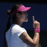 Photo - Li Na of China appeals a point as she plays Lucie Safarova of the Czech Republic  during their third round match at the Australian Open tennis championship in Melbourne, Australia, Friday, Jan. 17, 2014.(AP Photo/Rick Rycroft)