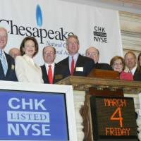 Photo - In this photo released by the New York Stock Exchange, New York Stock Exchange president and chief operating officer Catherine Kinney, second left, joins Chesapeake Energy Corporations president and chief operating officer Tom L. Ward, third left, Aubrey K. McClendon, chairman and chief  executive officer, fourth left with other board members and their guests for the opening bell at the New York Stock Exchange, Friday, March 4, 2005. (AP Photo/NYSE, Mel Nudelman)