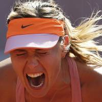 Photo - Russia's Maria Sharapova screams after scoring a point during final of the French Open tennis tournament against Romania's Simona Halep at the Roland Garros stadium, in Paris, France, Saturday, June 7, 2014. (AP Photo/Darko Vojinovic)
