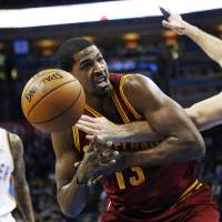 Photo -   Oklahoma City Thunder forward Nick Collison, right, knocks the ball away from Cleveland Cavaliers forward Tristan Thompson (13) in the second quarter of an NBA basketball game in Oklahoma City, Sunday, Nov. 11, 2012. Thunder guard Eric Maynor watches at left. (AP Photo/Sue Ogrocki)