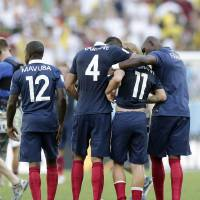 Photo - From left, France's Rio Mavuba, Raphael Varane, Antoine Griezmann and Eliaquim Mangala walk off the pitch after Germany defeated France 1-0 to advance to the semifinals during the World Cup quarterfinal soccer match at the Maracana Stadium in Rio de Janeiro, Brazil, Friday, July 4, 2014.  (AP Photo/Matthias Schrader)