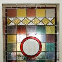 Photo - JOHN BODE / DENISE BODE / HOMEOWNERS: Stained-glass window from an old drug store on the upstairs landing of the 2009 Symphony Designers Show House at 431 NW 17 in Oklahoma City, Oklahoma, Thursday, April 16, 2009.  Photo by Steve Gooch, The Oklahoman ORG XMIT: KOD