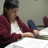 Photo - Glenda Hey, 60, sorts a pile of documents and correspondence recently from American Trade Association's health care plan.   PHOTO BY VALLERY BROWN,  THE OKLAHOMAN   ORG XMIT: 1003072204052705